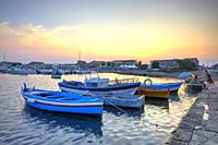 The little port of Marzamemi at sunset, Province of Syracuse, Sicily, Italy.