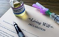 Living will declaration form Next to a vial of pentobarbital sodium to proceed to euthanasia, conceptual image.