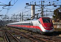 Italy, Lazio. Rapid train on the rail trip between Tivoli and Rome Termini Station.