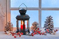 lantern on windowsill with christmas decoration.
