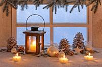 wooden lantern on windowsill with christmas decoration.