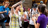 Youths enjoying purchases of Ice cream. Florence Italy.