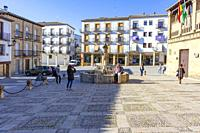 Baeza, Andalusia, Spain: View of tourists photographing themselves next to the fountain of the Lions of Baeza.