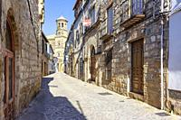 Baeza, Andalusia, Spain: View of one of the streets of the historical center of the city of Baeza with the cathedral in the background.