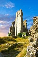 Medieval Corfe castle keep close up sunrise, built in 1086 by William the Conqueror, Dorset England.
