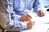 Stockholm, Sweden Businessmen review plans.