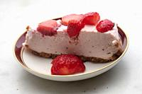 slice of strawberry cheesecake on white background, selective focus,.