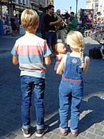 Young Siblings Listening to Street Musicians, Antwerp, Belgium.