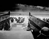 FRANCE Normandy -- 06 Jun 1944 -- Landing on the coast of France under heavy Nazi machine gun fire are these American soldiers, shown just as they lef...