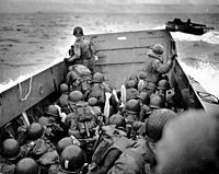 FRANCE Omaha Beach -- 06 Jun 1944 -- A US Navy landing craft approaches Omaha Beach in Normandy France with US Army and US Navy assault troops in the ...
