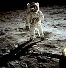 EARTH, THE MOON, Sea of Tranquility -- 20 Jul 1969 -- Astronaut Edwin E Aldrin Jr, lunar module pilot, walks on the surface of the Moon near the leg o...
