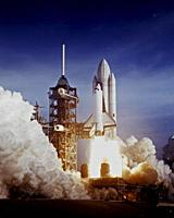 USA KENNEDY SPACE CENTER, FLA. -- 12 Apr 1981 -- After six years of silence, the thunder of manned space flight is heard again as the successful launc...