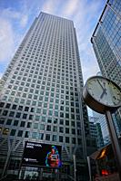 "One Canada Square Building. On the right the 20 Canada Square Building. The clock is part of the """"Six Public Cloks"""" by German designer Konstantin Gr..."