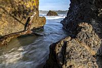 Rock formations on Espadilla Norte Beach, Manuel Antonio, Quepos, Costa Rica.