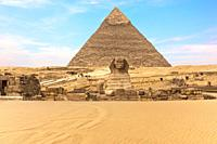 The Great Sphinx of Giza in front of the Pyramid of Khafre, Egypt.