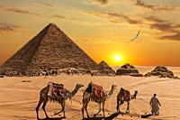 The Pyramid of Menkaure and the three pyramid companions, the camels and the bedouins in the desert.