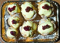 Zeppole of Saint Joseph, Italian pastry with flour, sugar, eggs, oil, decorated with a sour cherry. Father's Day cake.