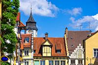 Historical housetops and steeple of the Minster of Our Lady in the Old Town of Lindau, Bavaria, Germany, Europe.