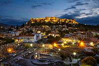 View of Acropolis from a roof top coctail bar at sunset, Greece. .