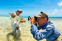 Man holding Bonefish to Fishing Photo in los Roques - venezuela.