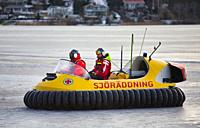 Open hovercraft of the Swedish Rescue Society on the ice of Lake Malaren.  A voluntary non profit organisation founded in 1907. Used on ice to rescue ...
