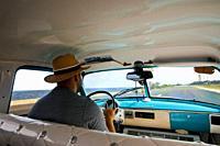Ciuban driver ina vintage car in Cuba.