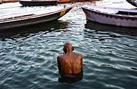 Hindu man bathing in the Ganges river ( Varanasi, India).