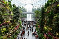 Singapore, Republic of Singapore, Asia - Interior view of the new Jewel Terminal at Changi Airport with indoor waterfall and Forest Valley, designed b...