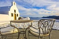 Church and terrace. Oia. Santorini. Cyclades islands. Greece.