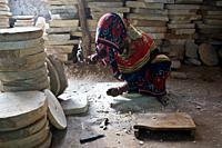 Female worker making a grinder ( Madhya pradesh, India).