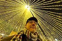 Man under christmas lights. Portugal.