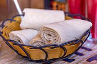 Rolls of Injera in a serving bowl. Injera is a sourdough flatbread made from teff flour. It is the national dish of Ethiopia, Eritrea, Somalia and Dji...