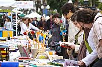 People browsing books at a stall on the Rambla Nova, Tarragona, during the day of Sant Jordi (April23) the patron saint of Catalonia, Spain. Tradition...