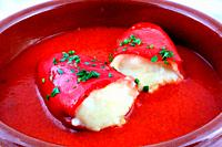 Casserole red peppers stuffed with fish and accompanied by tomate sauce