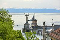 View over the lighthouse and the statue of the Imperia by Peter Lenk, as well as the Zeppelin memorial in the harbour of Konstanz at Lake Constance, B...