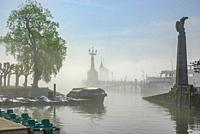 Konstanz, Baden-Wurttemberg, Germany, Europe: Mist from Lake Constance covers the harbour.