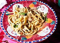 Scialatielli pasta with seafood mix on the plate.