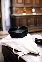 priest's hat with dress and breviary.