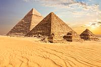 Beautiful sunset view of the Pyramid of Menkaure with companions and the Pyramid of Chephren, Egypt.