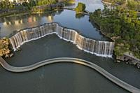 Aerial view of the Kunming Waterfall Park at sunset, one of the largest manamde waterfalls in the world.