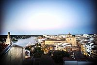 View of the port and city at dusk. Mahon Menorca, Balearic Islands, Spain, Europe.