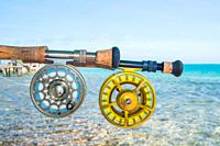 Saltwater fly fishing fly rod and reel an the beach in Caribbean sea - los roques.