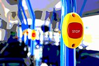 Stop button on a modern, colorful city bus close up. Filtered image.