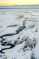 Winter, crooked river, Medallandssandur, South Coast, Iceland.