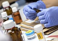 Scientific Police takes blood sample at Laboratorio forensic equipment, conceptual image.