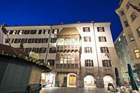 Innsbruck city center Austria on April 16, 2019: Easter market and golden roof by dusk.
