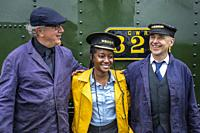 Tourist and workers, firemen, Llanfair and Welshpool Steam Railway, Wales.