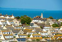 Rooftops at Southwell on the Isle of Portland near Portland Bill with the sea on the horizon. Dorset. England. UK.