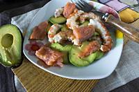 Prawns with avocado and smoked salmon.