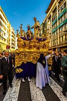 A paso (float) of Jesus Christ in the procession of the Brotherhood (Hermandad) San Benito, Holy Week (Semana Santa), Seville, Andalusia, Spain.